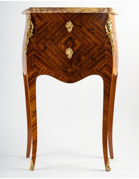 A Pair of bedside tables in Louis XV style.
