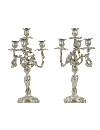 A Pair of silvered candlesticks in...