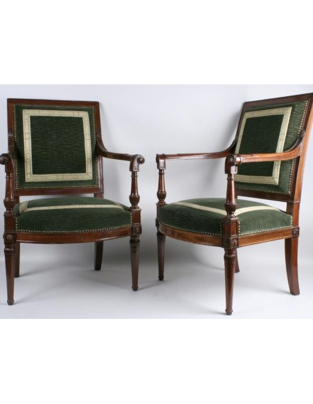 A Directory (1795-1799) period pair of mahogany armchairs from the Saint Cloud castle.