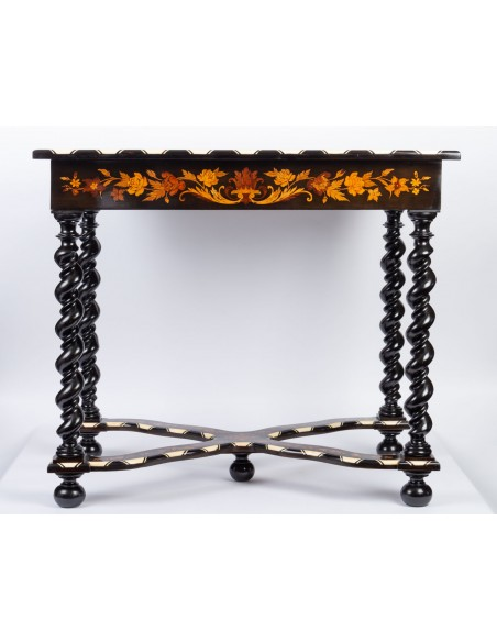 A Napoleon III period (1848 - 1870) marquetry table in Louis XIV style. 19th century.