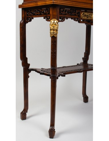A Vitrine-cabinet-on-stand attributed...
